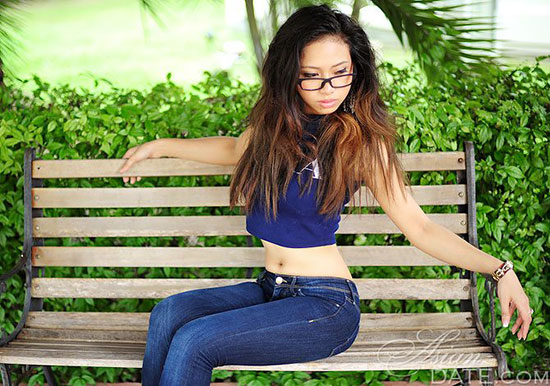 simple thai girl sitting on a bench