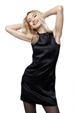 Belarus blonde wearing a shiny black dress