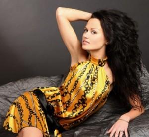 Single Ukrainian Woman posing in a yellow dress