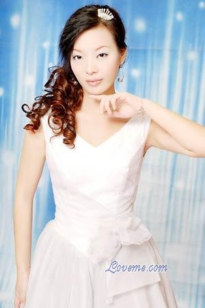 Beautiful Chinese woman in a white dress