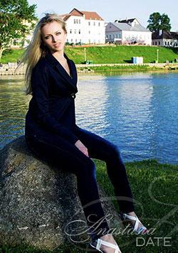 Blonde Belarusian sitting on a rock