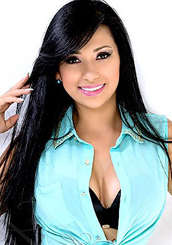 Elegant Colombian beauty in a black and blue combination tops