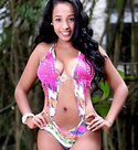 sensual-colombian-girl-wearing-a-sexy-colorful-one-piece-swimsuit