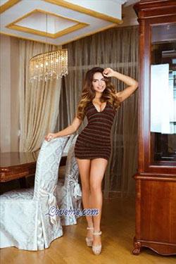Ukrainian child psychologist in a brown sexy dress