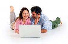 Couple looking at dating site on computer