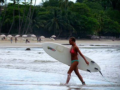 Costa rican surfer girl at beach
