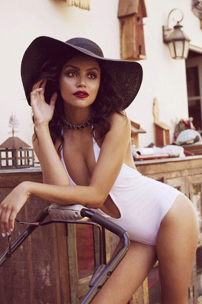Bianca Alex Santos in a white bikini and hat