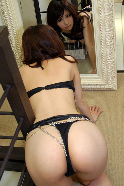 Harumi Asano looking herself in the mirror