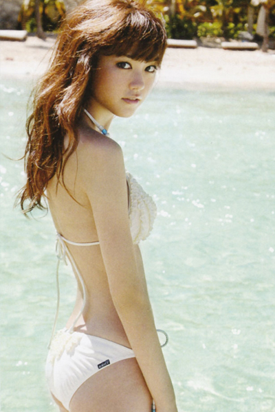 Mirei Kiritani stunning at a blue watered resort