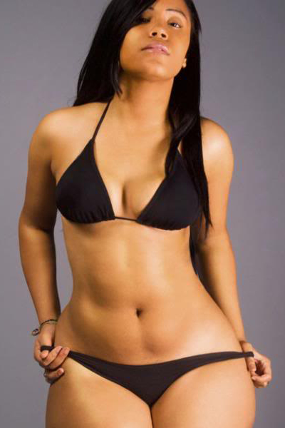 Mizz DR posing wearing a black 2 piece bikini