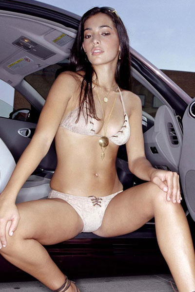 Natalie Martinez modelling for a car
