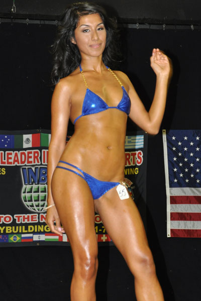 Valerie Cruz in blue two-piece swimsuit