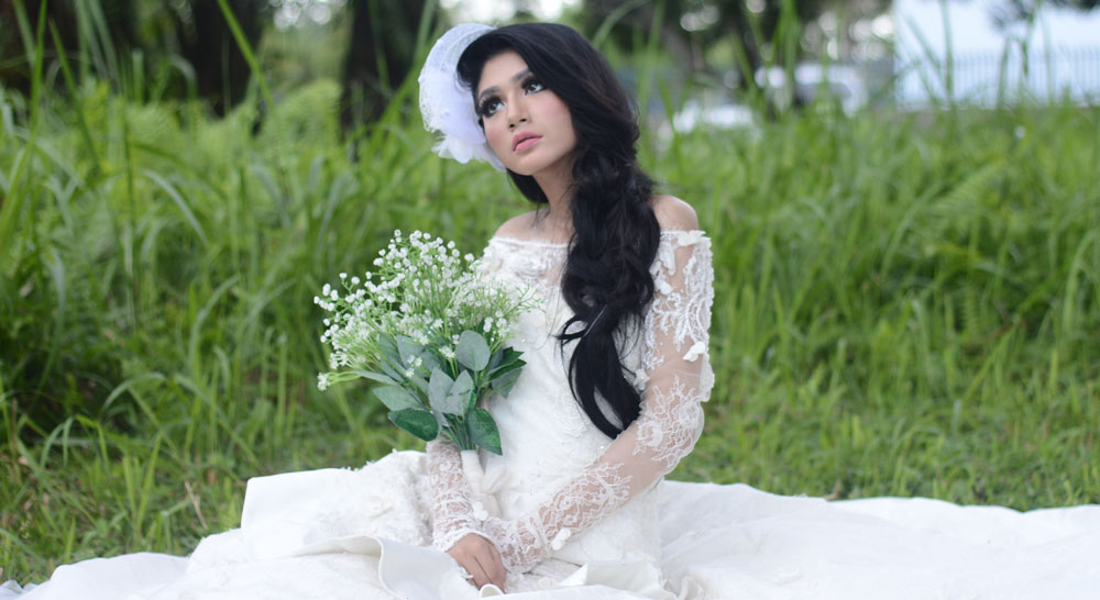 Beautiful Asian woman in bridal gown