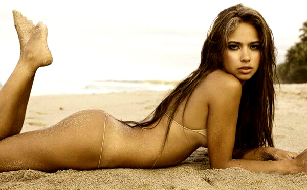 Catalina Otalvaro covered in sand