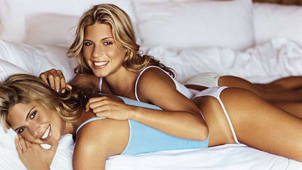 Beatriz and Branca Feres in bed