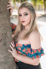 blonde Brazilian girl beside the tree pictorial
