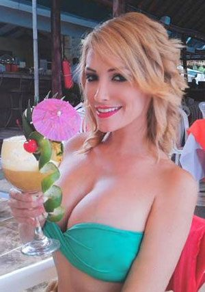 blonde Costa Rican lady looking refreshed in her cocktail