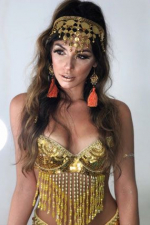 Brazilian girl in golden belly dancer dress