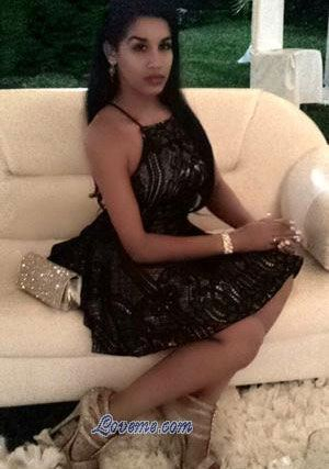 classy Dominican girl sitting on the couch