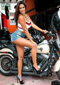 hot Mexican girl beside a motorcycle