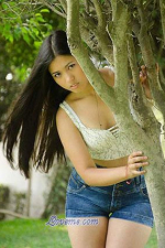 Peruvian babe behind the tree