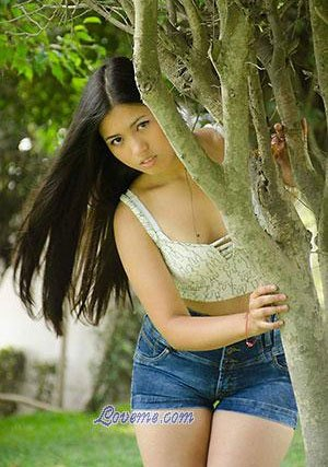 Peruvian babe behind the tree