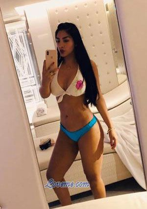 Peruvian girl taking a selfie in front of the mirror
