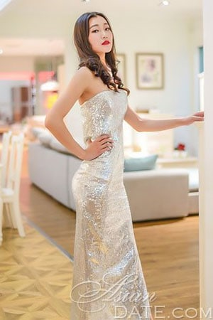 petite Chinese babe in long shiny dress