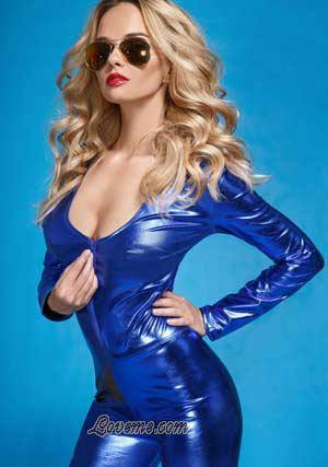 seductive hot Belarus girl in blue leather suit