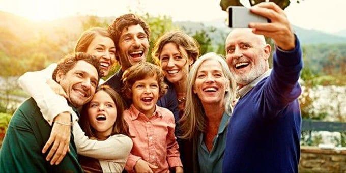 a happy family taking a selfie