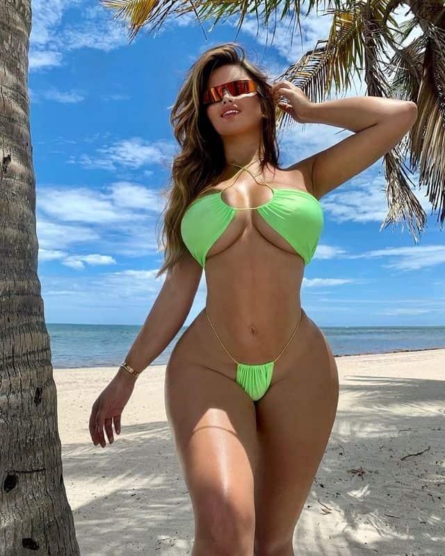 Anastasia Kvitko showing her sexy body on the beach