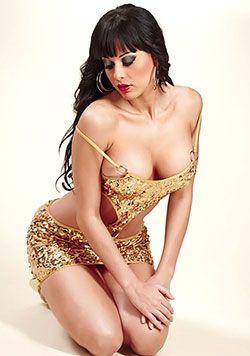 bewitching Latina babe in gold dress
