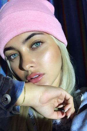 blonde Colombian cute in pink bonnet