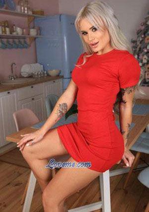 blonde tattooed girl in a hot red dress
