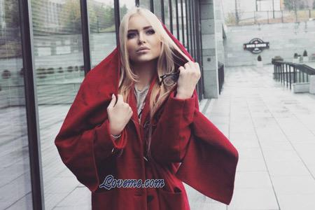 blonde Ukrainian in a hot red trenchcoat