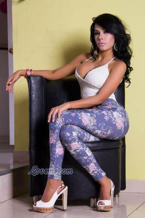 charming Colombian babe sitting on a chair