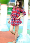 charming Viet girl in a checkered blouse
