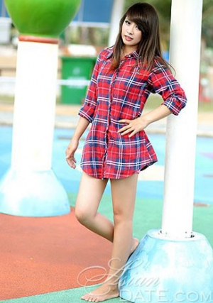 charming Vietnamese girl in a checkered blouse