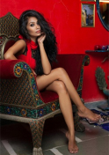 cute Indian lady sitting on a couch