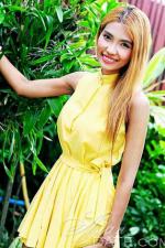 cute Thai babe in a sunny yellow dress