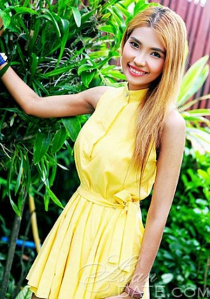 cute Thai babe in a sunny yellow dress
