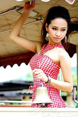 cute Thai girl holding a bell