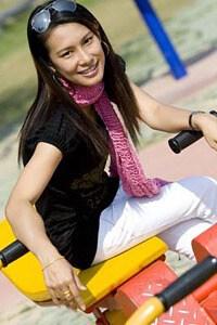 cute Thai lady at a seesaw
