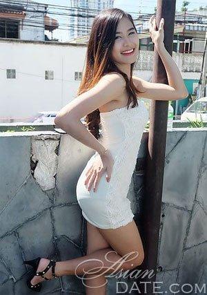 cute Thailand girl posing outdoors