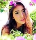 desirable Thailand girl in a flower garden