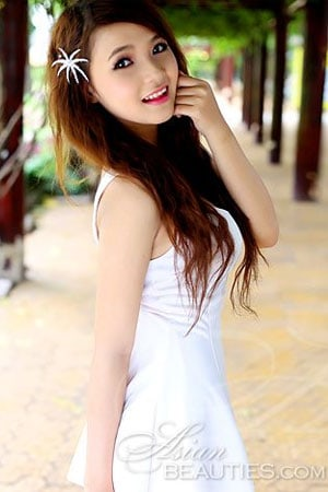 desirable Viet girl in a simple white dress