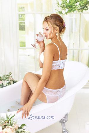 hot Belarus blonde drinking while in tub