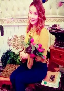 Kazakh girl holding a bunch of flowers