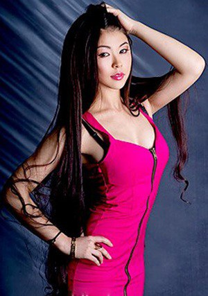 long-haired Kazakh babe in a cute pink dress