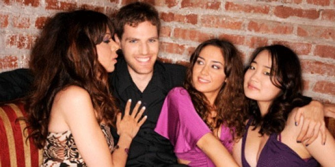 man surrounded with three beautiful women